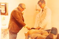 J. Lamoine De Rusha and student treating a patient