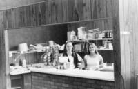 Two female students working in the cafeteria on the Northwestern College of Chiropractic campus