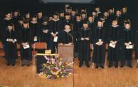 President and faculty at chiropractic graduation