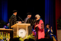 Northwestern Health Sciences University's new President Dr. Deb Bushway receiving Presidential medallion