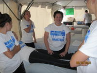 Northwestern Health Science's University students giving massages to participants of Grandma's Marathon