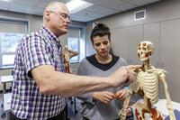 Northwestern Health Sciences University faculty member and student in an anatomy class