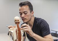 Northwestern Health Sciences University student in an anatomy class
