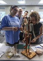 Northwestern Health Sciences University faculty member and students in an anatomy class
