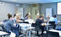 Northwestern Health Sciences University students in an anatomy class