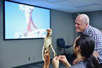 Northwestern Health Sciences University faculty member and student during an anatomy class