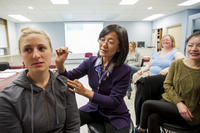 Northwestern Health Sciences University students watching an acupuncture demonstration