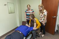Chiropractic students learning techniques