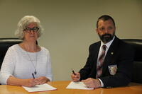 International Federation of Sports Chiropractic contract signing with Northwestern Health Sciences University