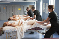 Northwestern Health Sciences University massage therapy students practicing techniques