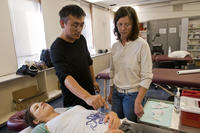 Students learning acupuncture techniques