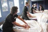 Massage therapy students practicing their techniques