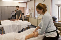Northwestern Health Sciences University massage therapy students practice techniques