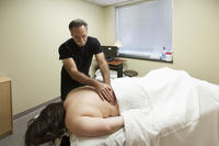 Northwestern Health Sciences University massage therapy student giving massage to patient