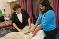 Northwestern Health Sciences University student practicing massage technique