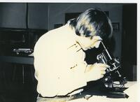 Chiropractic student looking through a microscope