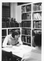 Woman studying in the library on the Northwestern College of Chiropractic campus
