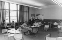 Groups of students gathered in a lounge area