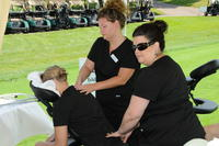 Northwestern Health Sciences University students giving massages to golf tournament participants