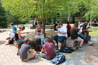 Students eating in the Healing garden