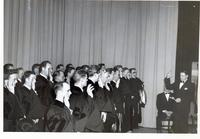 Administering the oath of professionalism to new graduates