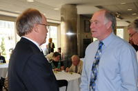 Northwestern Health Sciences University President Jeff Nelson talking with another man