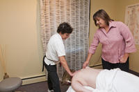 Northwestern Health Sciences University massage therapy student practicing techniques