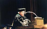 Northwestern College of Chiropractic faculty member Dr. J. Lamoine De Rusha speaking at a graduation ceremony