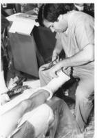 Student removing a leg cast
