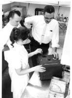 Three people working in a lab